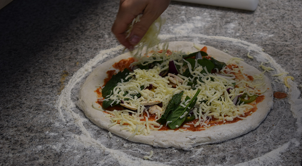 making a pizza with toppings