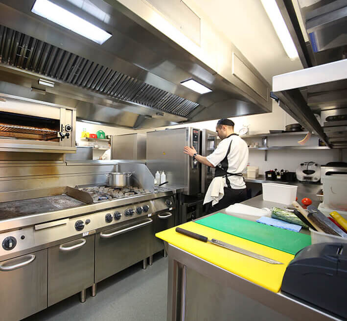 Acme Finance chef in commercial kitchen