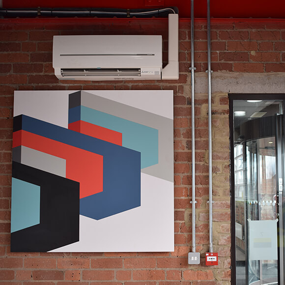 air conditioning installation with artwork on wall